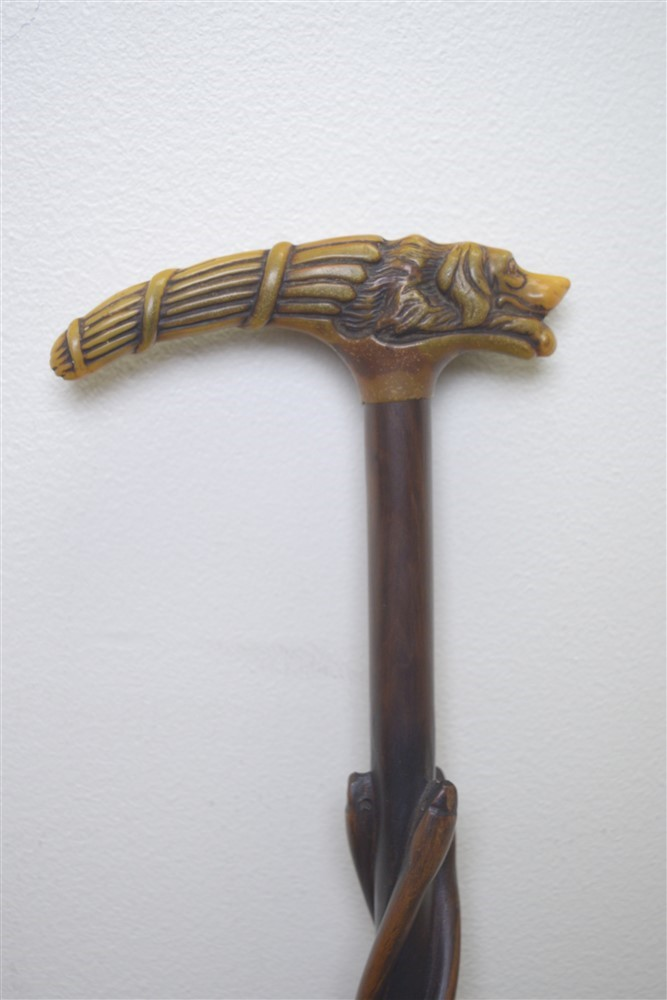 Brass Handled Carved wooden walking stick